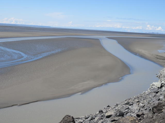 The glacial silt creates a natural boundary for the water
