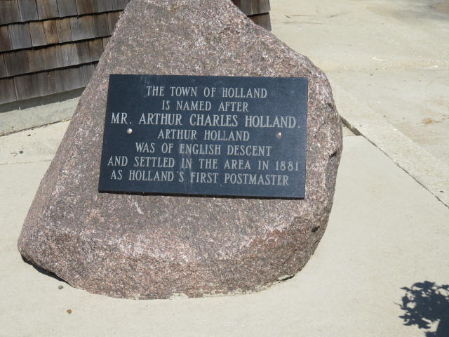This plaque tells the story of how Holland, MB really got its name